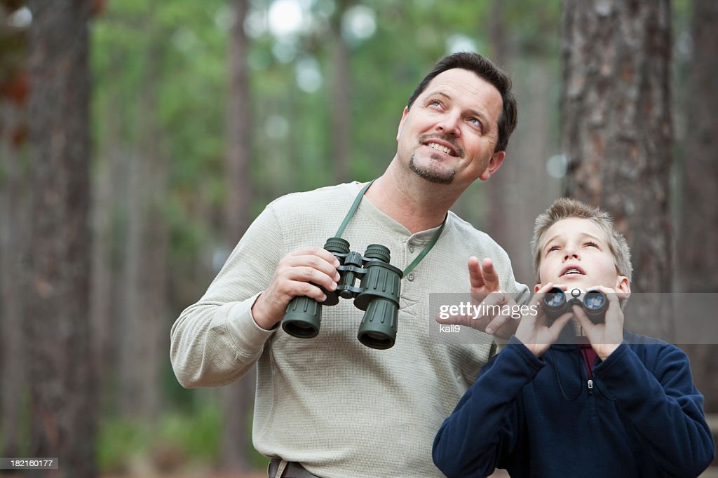 Father and son enjoying scenic view with binoculars : Stock Photo