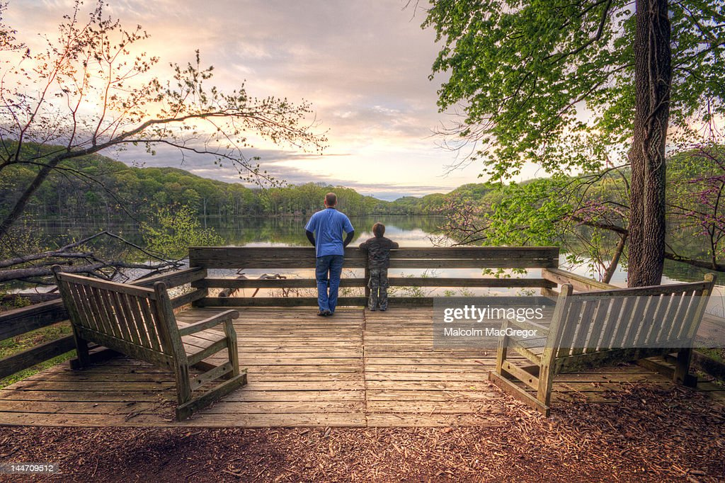 Father and son enjoying sunrise : Stock Photo