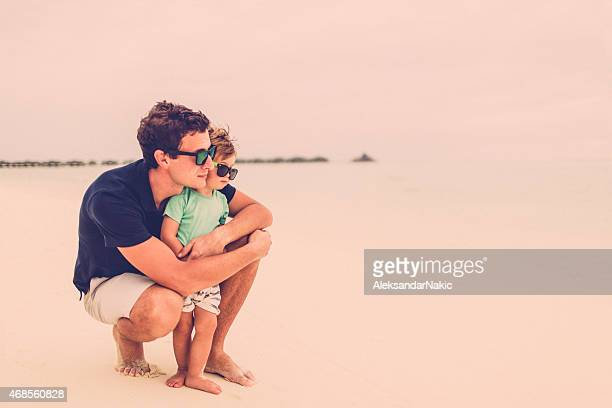 Father and son enjoying the view at the beach