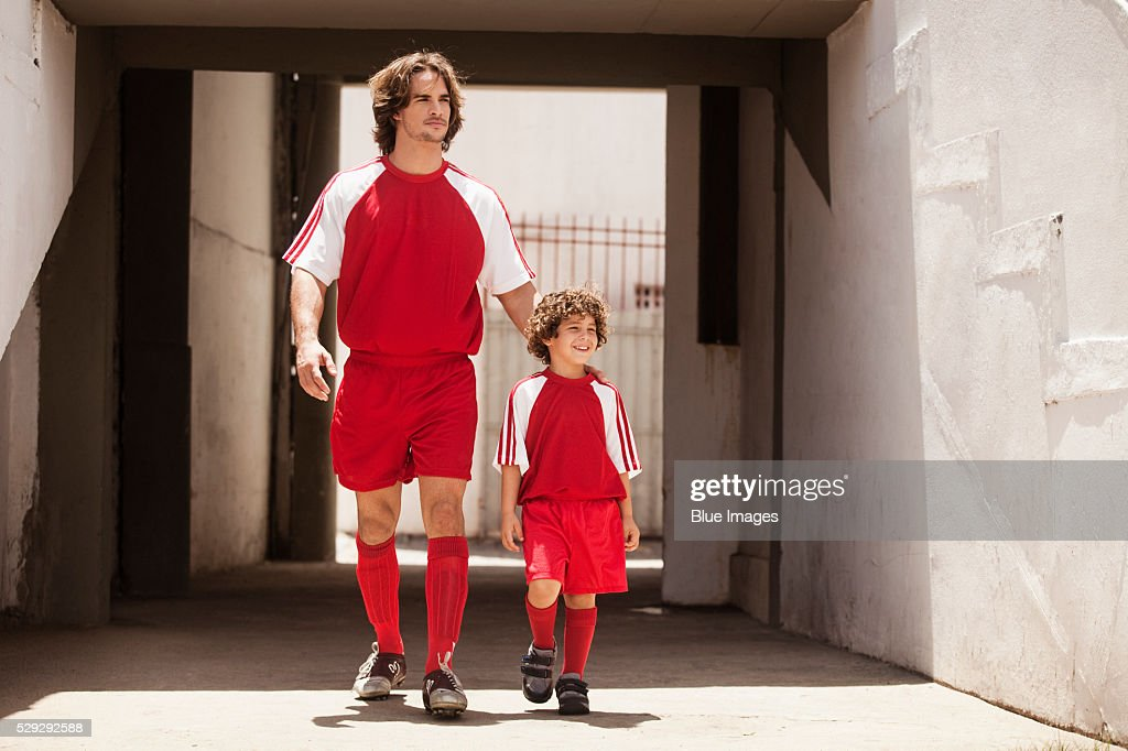 Father and son entering soccer stadium : Stock Photo
