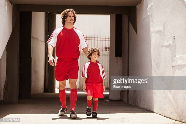 Father and son entering soccer stadium