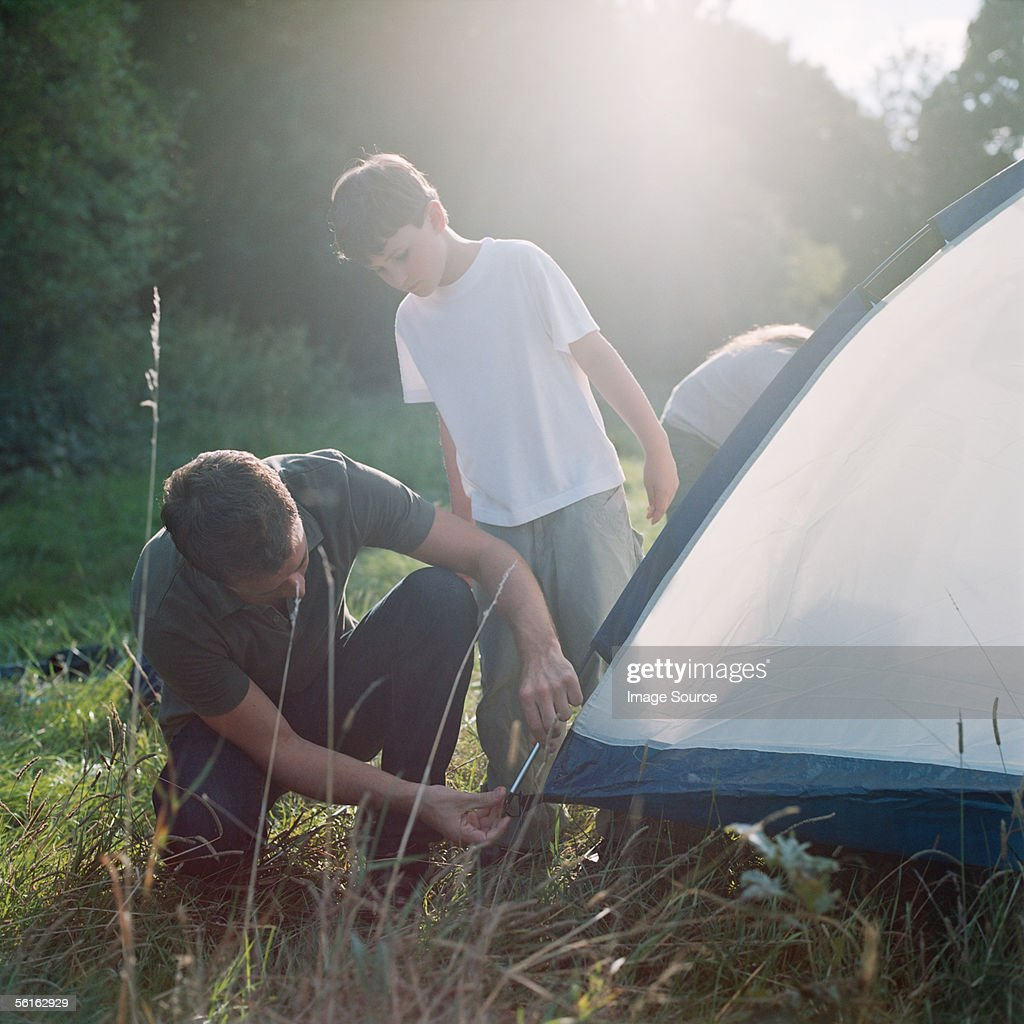 Father and son erecting a tent : Stock Photo