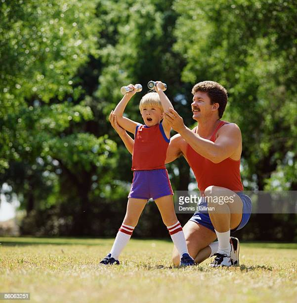 Father and son exercising at the park