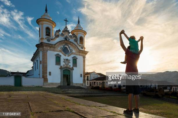 father and son exploring mariana church - brazil stock pictures, royalty-free photos & images
