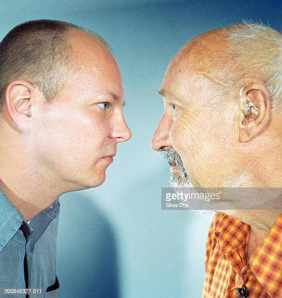 """""""father and son face to face, close-up"""" - confrontation stock pictures, royalty-free photos & images"""