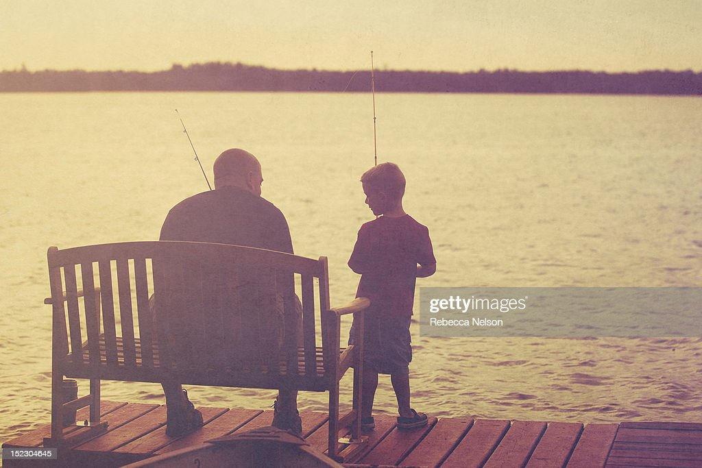 Father and son fishing onpier : Stock Photo