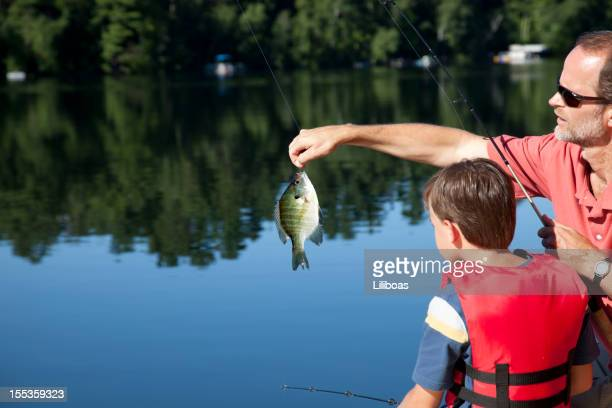 father and son fishing - freshwater sunfish stock photos and pictures