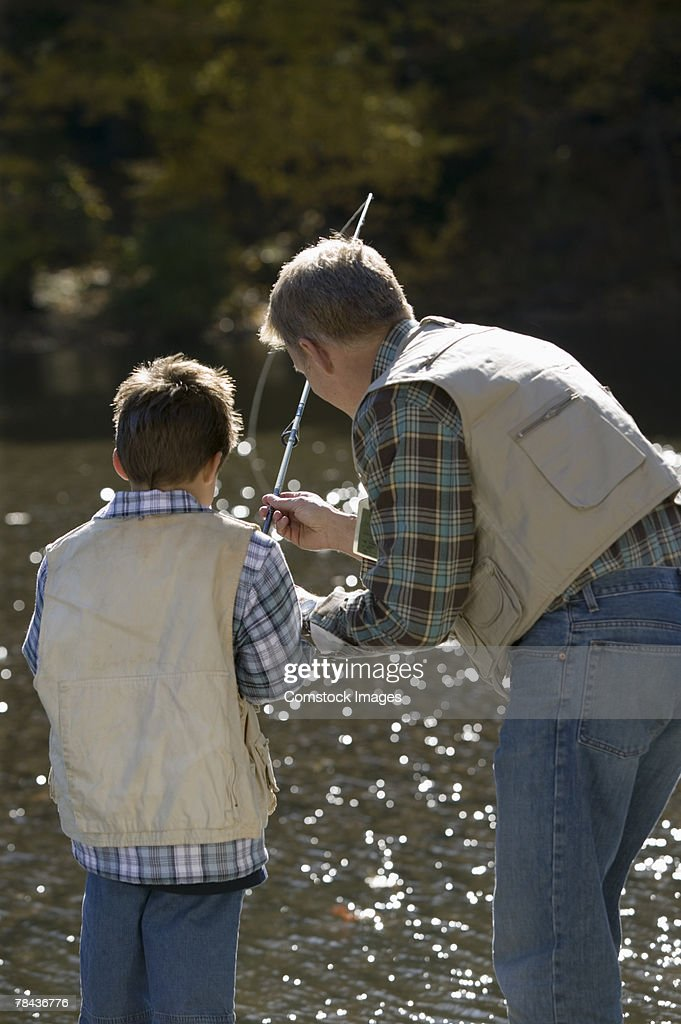 Father and son fishing : Stockfoto