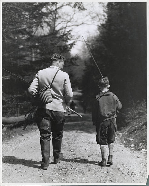 Father and Son Strolling for Fishing in Wooded Area