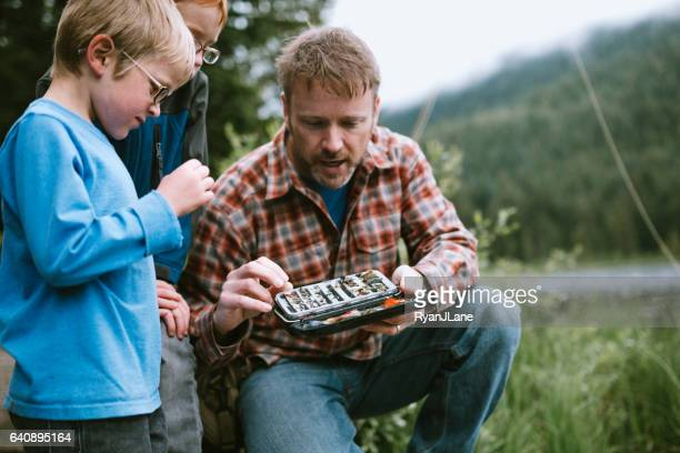 father and son fishing trip - fly casting stock pictures, royalty-free photos & images
