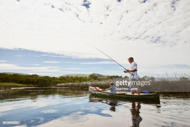 father and son fishing trip - bateau à rames photos et images de collection