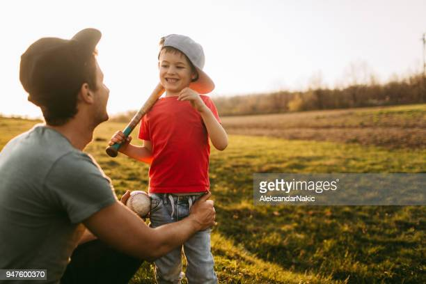 father and son getting ready for a game of baseball - baseball sport stock pictures, royalty-free photos & images