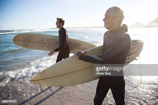 Father and son going surfing together