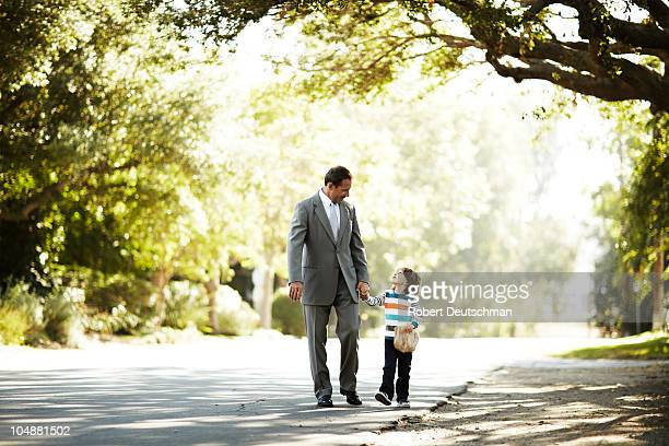 Father and son going to school