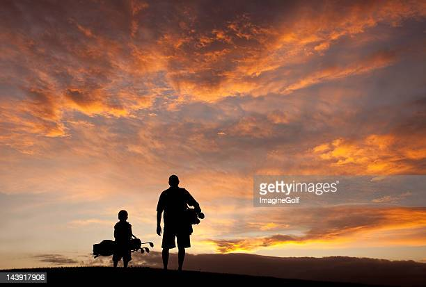 father and son golf silhouette - fathers day stock pictures, royalty-free photos & images
