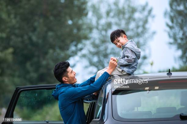 father and son happy east - china east asia stock-fotos und bilder