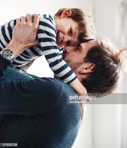 father and son have fun together - fathers day stock pictures, royalty-free photos & images