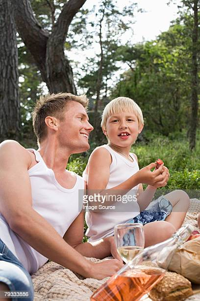 Father and son having a picnic