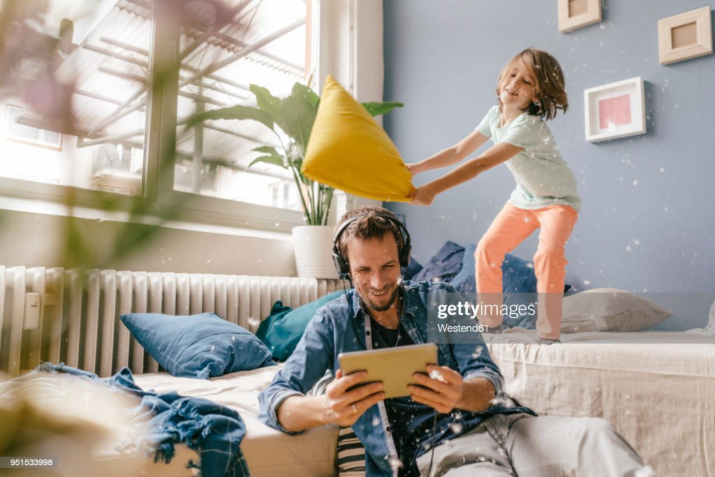 Father and son having a pillow fight at home : Stock-Foto