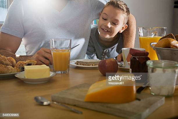 Father and son having breakfast together