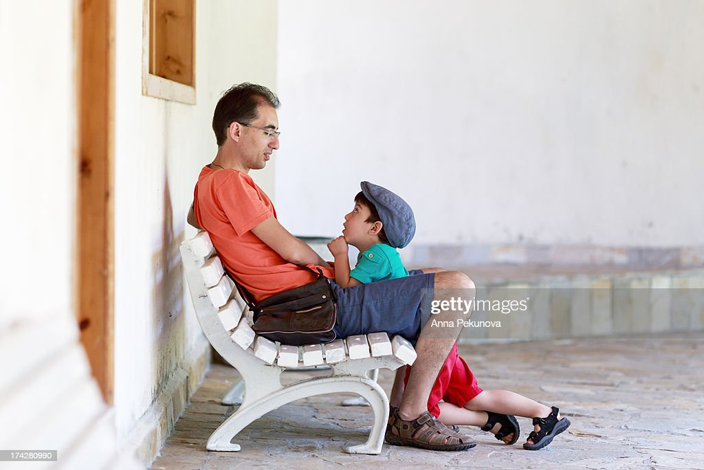 Father and son having conversation : Stock Photo