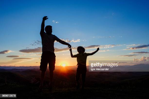 Father and son having fun at sunset