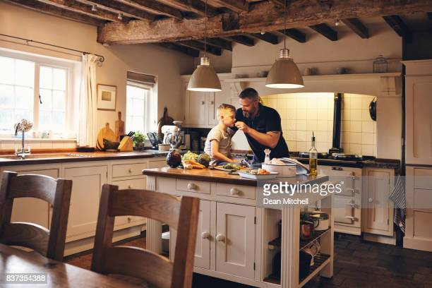 Father and son having fun in the kitchen