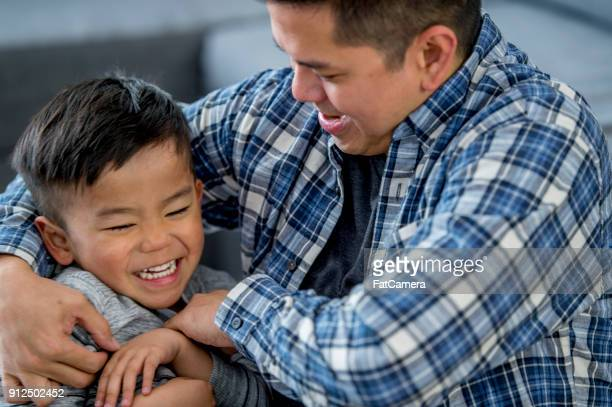 father and son having fun - fatcamera stock pictures, royalty-free photos & images