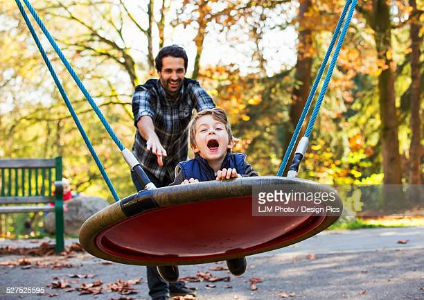 Father and son having fun together at a playground