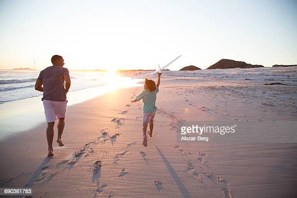 Father and son having fun together on the beach