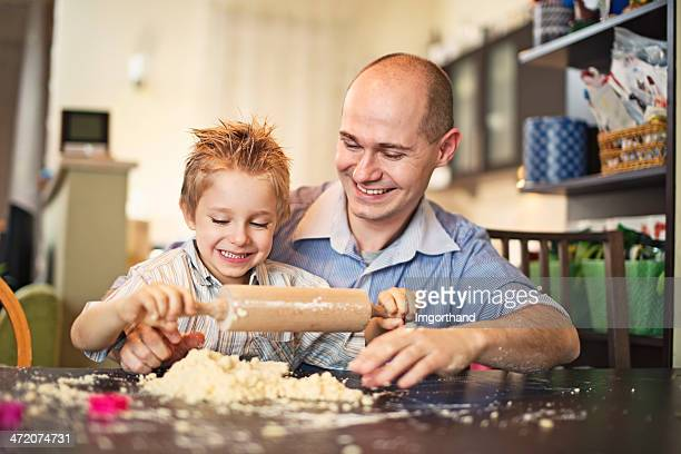 Father and son having fun with baking