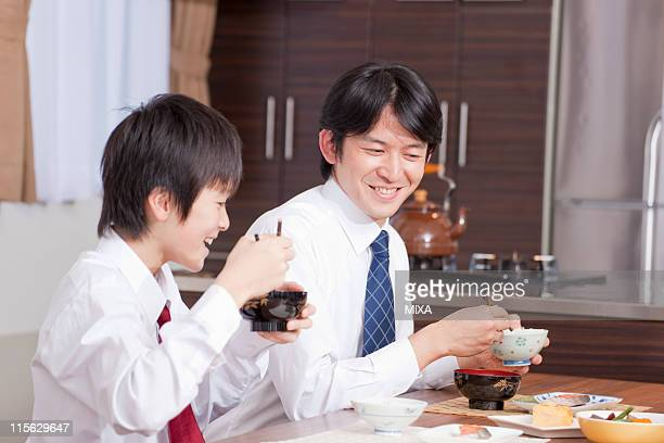 Father and Son Having Japanese Cuisine Breakfast