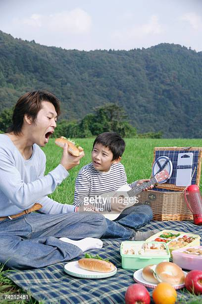 Father and son having picnic
