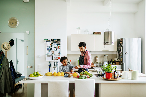 Father And Son Helping Each Other Prepare Some Lunch - gettyimageskorea