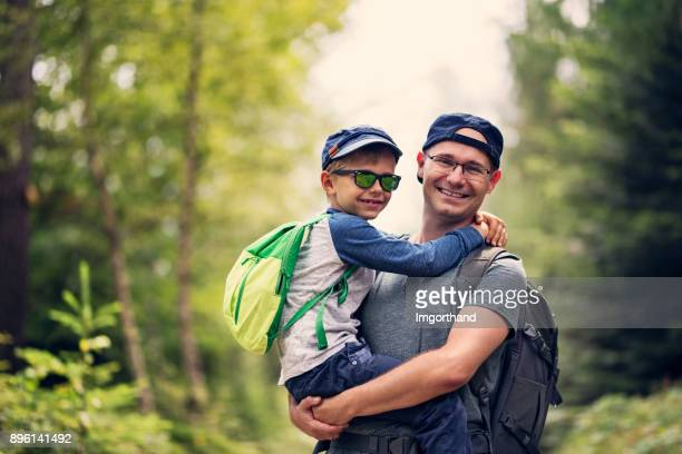 father and son hiking in forest - imgorthand stock photos and pictures