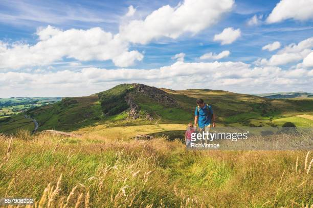 father and son hiking in peak district - peak district national park stock pictures, royalty-free photos & images