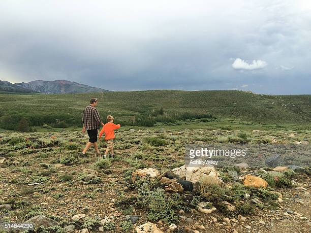 Father and son hiking in the beautiful wilderness of California