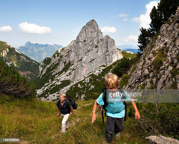 Father and son hiking on mountain path