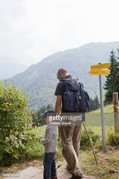 father and son hiking - berchtesgaden stock-fotos und bilder