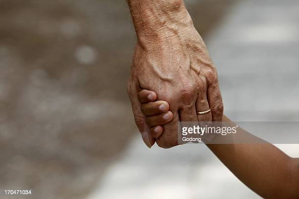 Father and son holding hands Italy