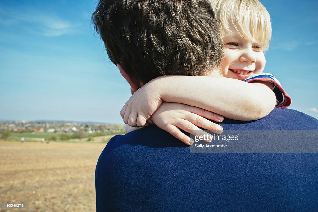 Father and son hugging : Stock Photo