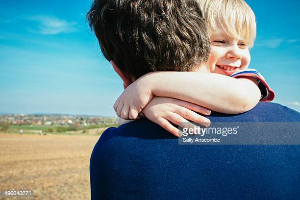 father and son hugging - single father stock pictures, royalty-free photos & images
