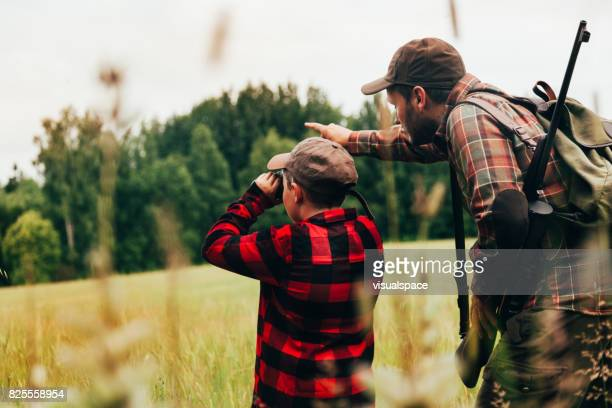 father and son hunting for boar - hunting sport stock pictures, royalty-free photos & images