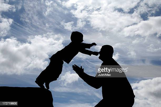 father and son ii - leap of faith stock photos and pictures