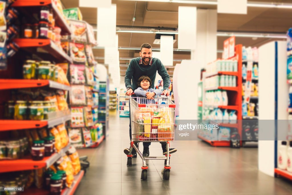 Father and Son In A Supermarket. : Stock Photo