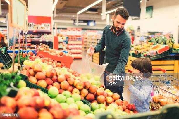 Father and Son In A Supermarket.