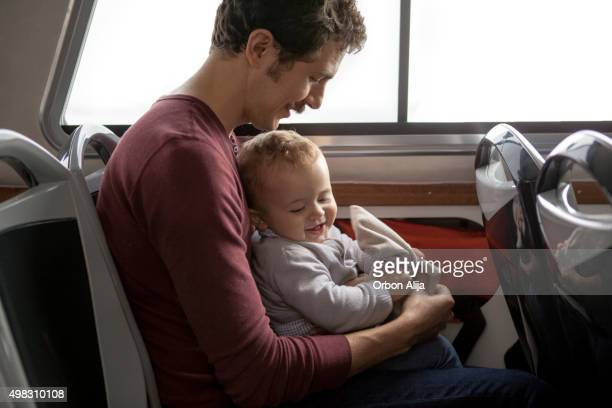 father and son in a vaporetto - vaporetto stock photos and pictures