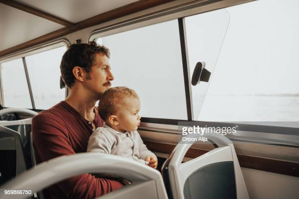 father and son in a vaporetto - vaporetto stock pictures, royalty-free photos & images