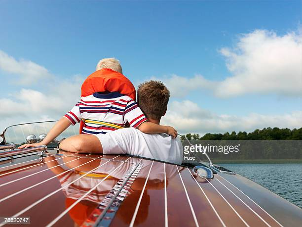 Father and Son in an Old Speed Boat