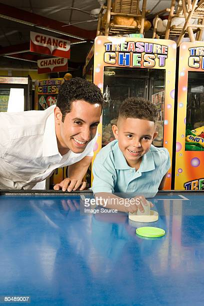 Father and son in arcade